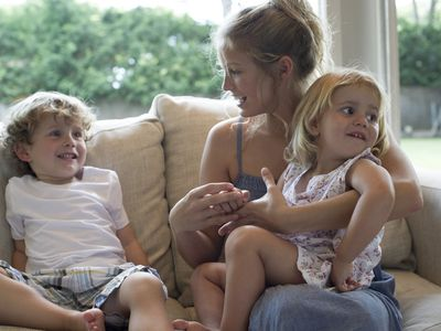 college student working a part-time babysitting job with two young children