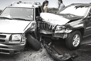 Man and woman at car accident