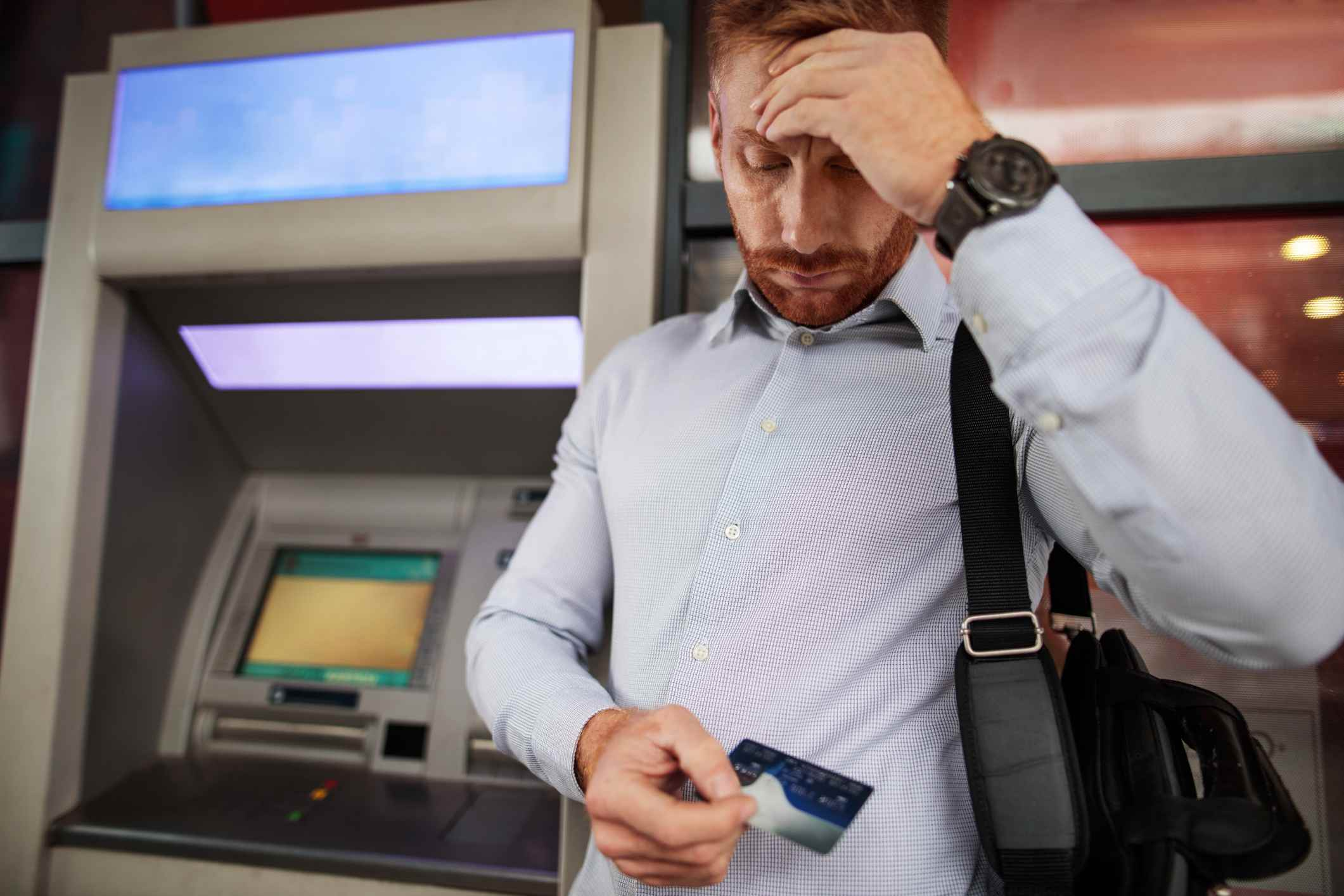 Stressful businessman doesn't have enough money on his credit ca