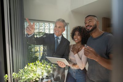 Realtor showing a property to a couple