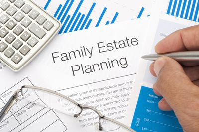 Family estate planning papers being signed