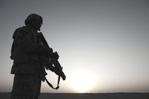 Military soldier over sunset