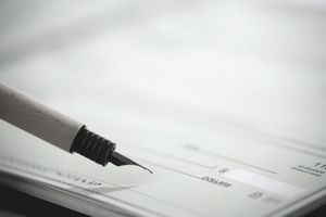 Close-up of a fountain pen on a check