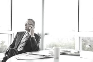 Businessman talking on phone in boardroom