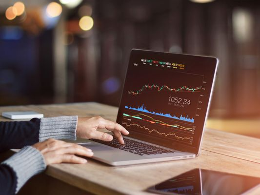 Businessman using laptop for analyzing data stock market, forex trading graph, stock exchange trading online, financial investment concept