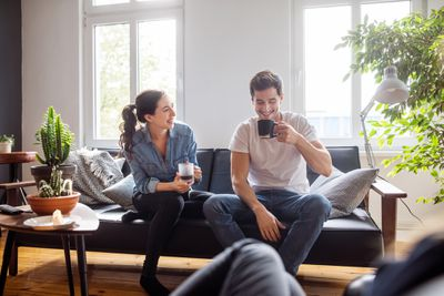 A young couple enjoys their first morning in their new HomePath home.
