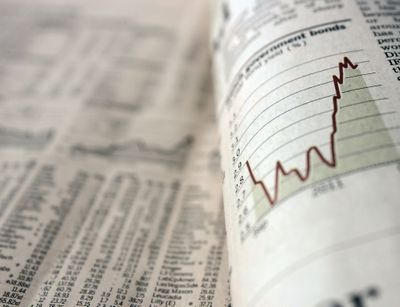 newspaper showing market giving high earnings for high risks