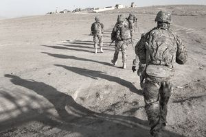 U.S. Army soldiers walk toward Checkpoint 64 near Loy Karez, Kandahar province, Afghanistan, to meet with local leaders