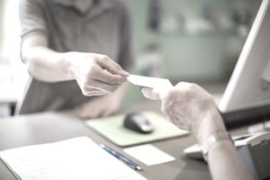 A health care patient pays for medical services.