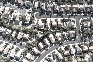 Arial view of homes after economic growth of a suburban development after a municipal tax abatement program.