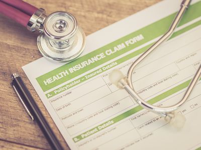 A stethoscope and insurance form of a patient ready to file their health insurance claim