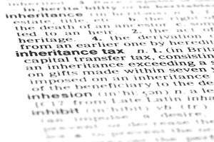 a close up of the definition of inheritance tax in a dictionary