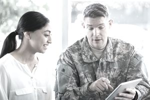 Military man holding digital tablet in recruitment office