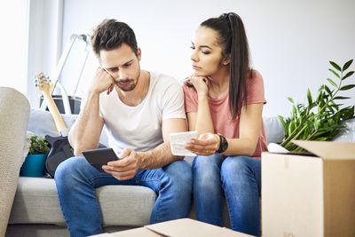 Serious couple discussing separate checking accounts