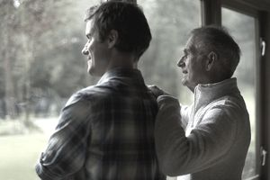 Thoughtful father and son in cottage
