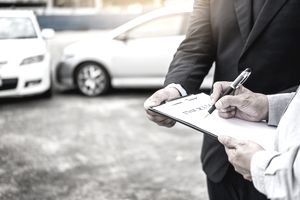 Man Signing Car Insurance Form