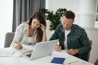 Husband and wife preparing bills to pay