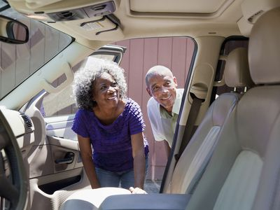 Older Couple Buying a Car