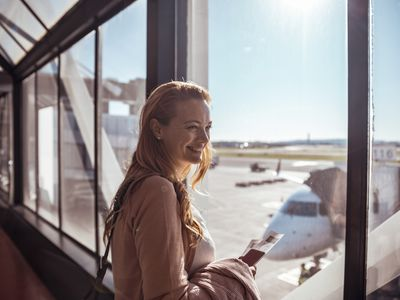 A woman waits for her flight.