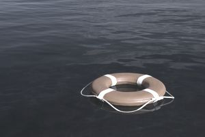 Round life preserver floating in water signifying an emergency situation