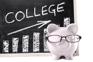 """Chalkboard with """"college"""" behind a piggy bank"""