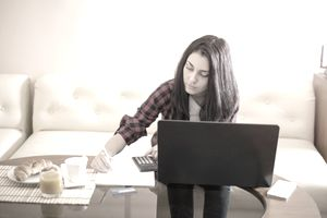 Young woman reviewing personal loan and credit card finances