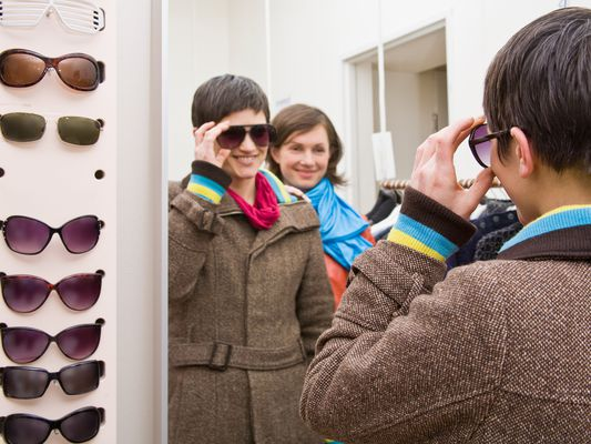Women buying sunglasses
