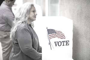 Woman with long gray hair at voting booth