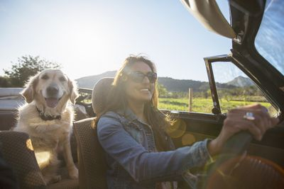 Woman and dog in a car
