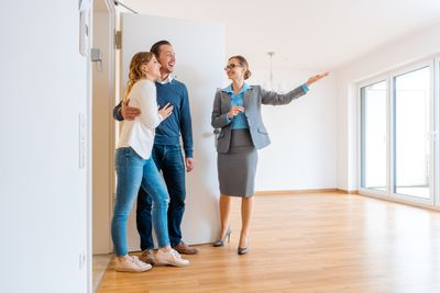 Realtor showing apartment to young couple
