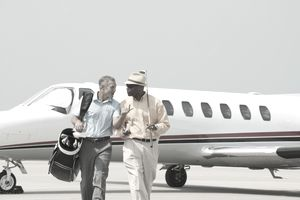 Millionaire golfers getting off a private plane