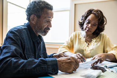 A couple looks over the details of estate taxes in their state.