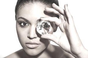 Woman looking through a diamond at a Roth IRA statement.