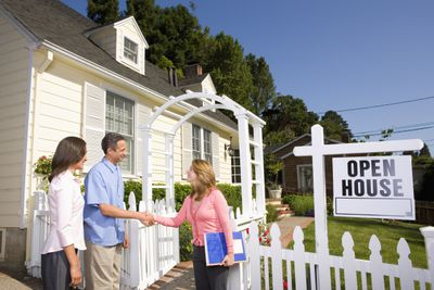 Couple being greeted by a female realtor at an Open House, with hopes to get a first right of refusal contingency