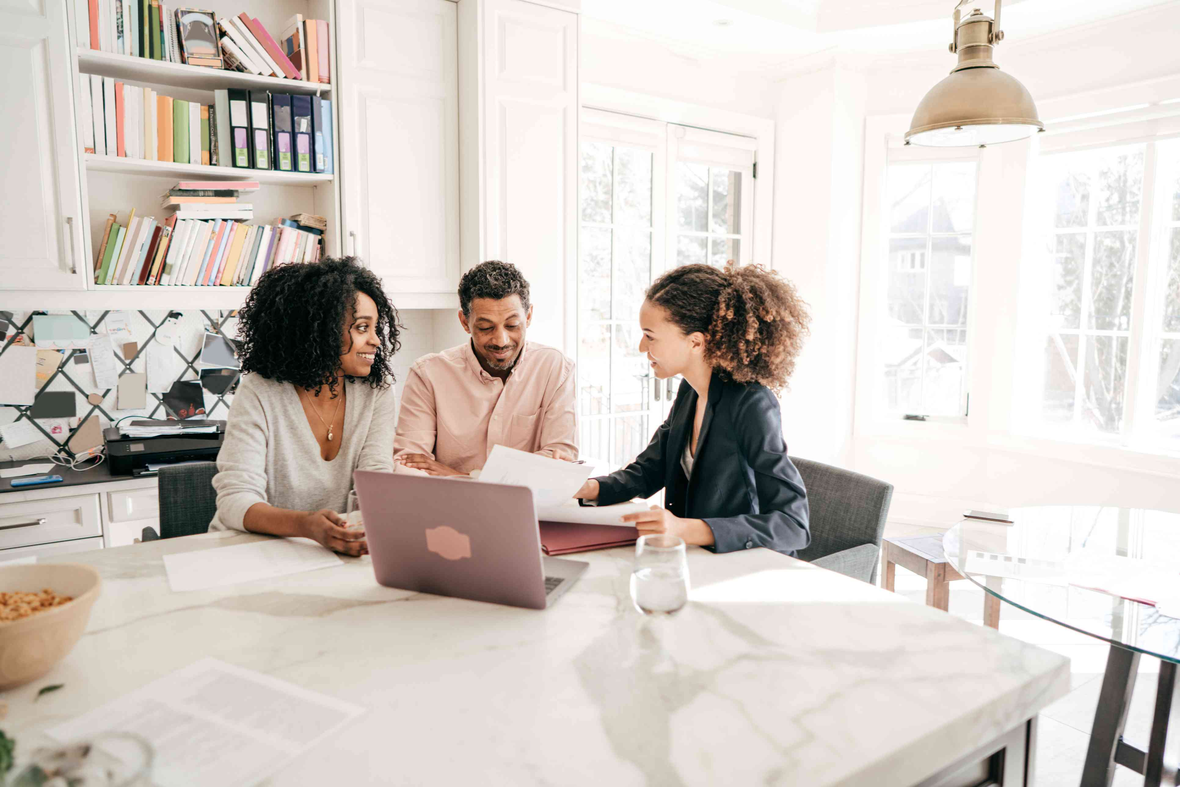 Entrepreneurs evaluating tax forms with a professional