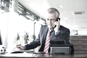 Businessman answering a phone call