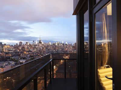 A balcony view of Manhattan during sunset