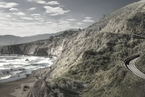 Dramatic Northern California Coastline showing a highway winding along the rocky shoreline.