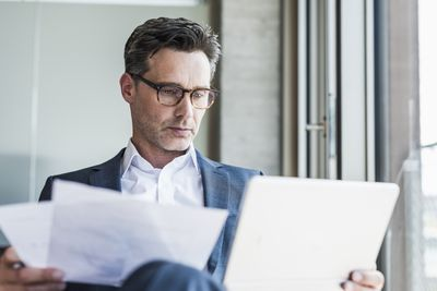 A person looks over documents