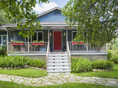 An older patio home with a porch out front