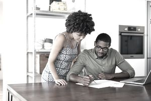 A couple looks over their refinancing documents.