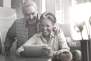 Couple looking at retirement information on a tablet