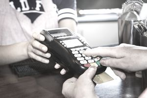 Customer uses a credit card to pay for a purchase in a retail store