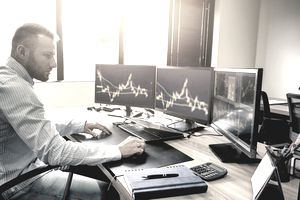 Young business person trading commodities