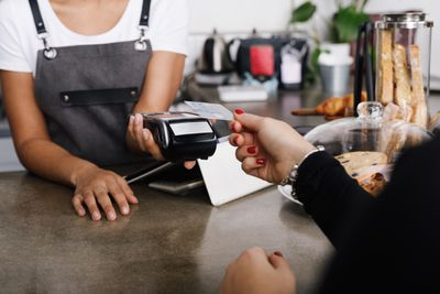 Woman making a credit card payment to a small business