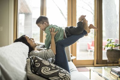 A mother plays with her son in their new home.