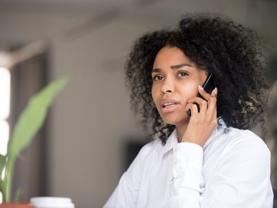Woman on phone with her broker learning about margin call