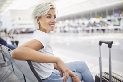 A traveler waits for her flight to Iceland.