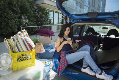 Student on mobile device purchasing renters insurance and moving