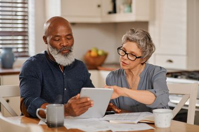 Couple working on a tablet looking at financial statements